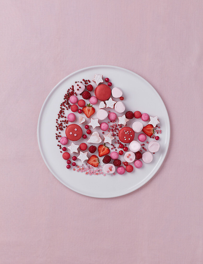 Arrangement for Valentines day with pink candies and strawberries