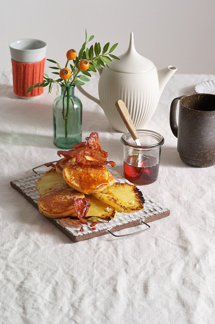 Ricotta and almond pancakes with bacon, pineapple and maple syrup