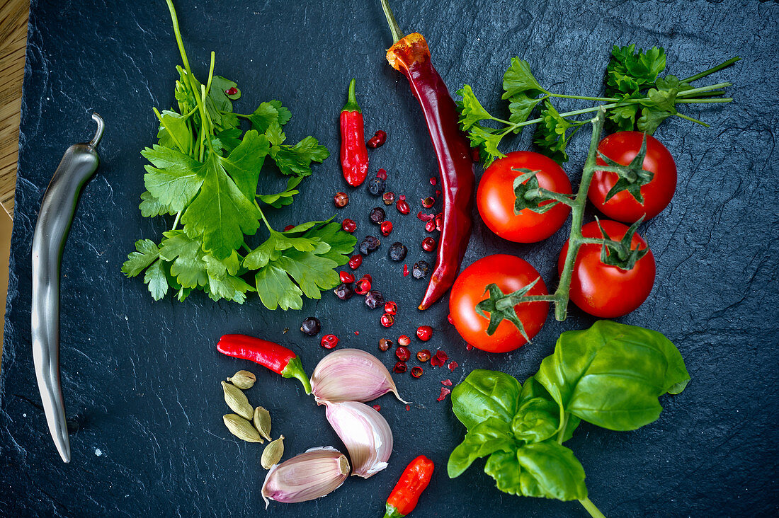 Chilli, garlic, coriander, tomatoes, basil, parsley, cardamon and pepper corns