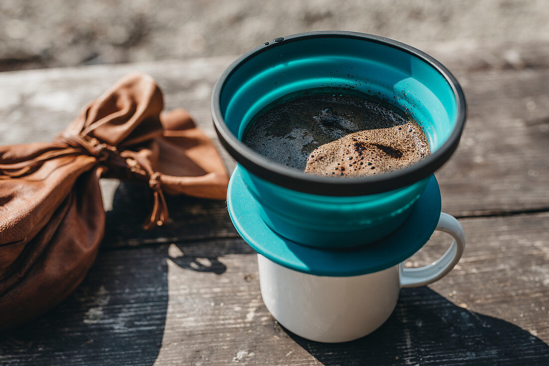 Coffee in a filter on a mug
