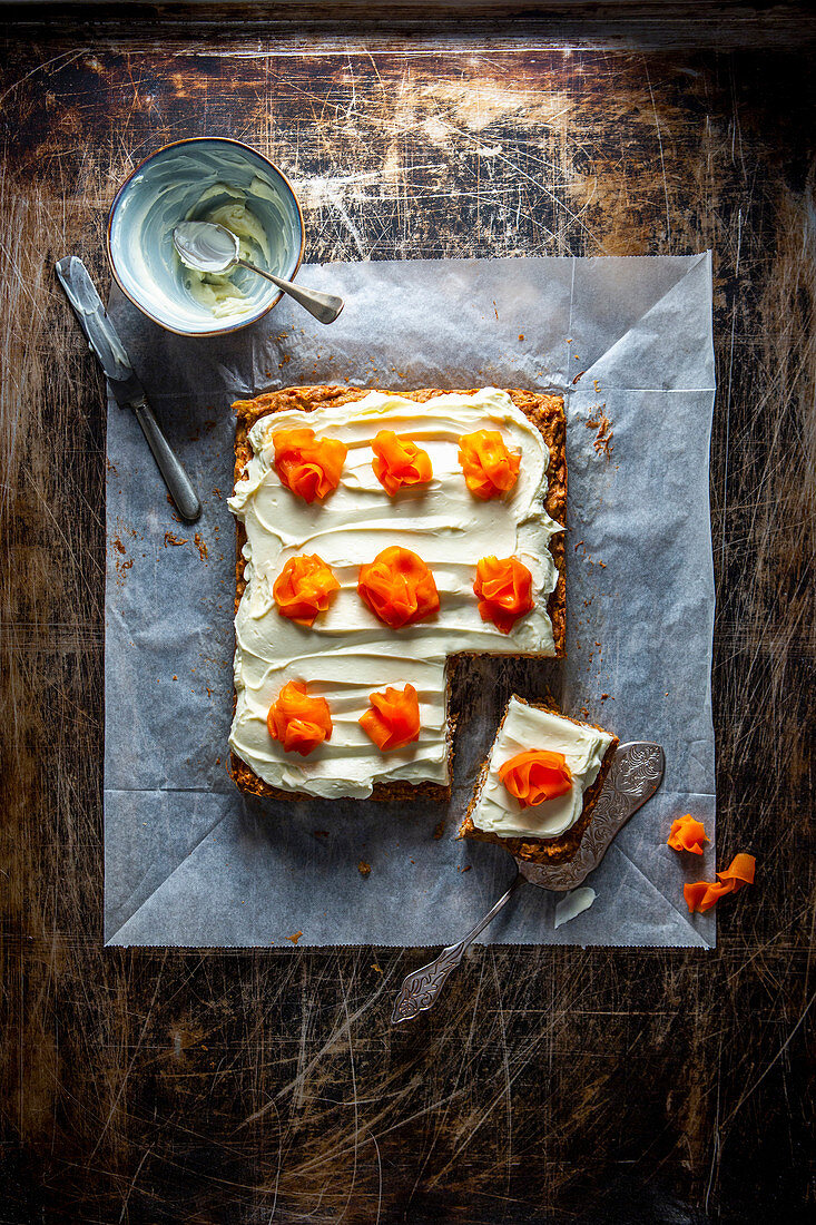 Pineapple and carrot cake with cream cheese frosting and candied carrots