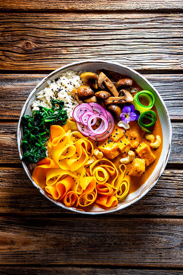 Carrot curry bowl with paneer and cashew nuts