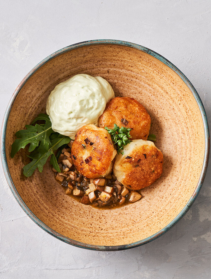 Fried potato fritters with tarragon cream and mushroom ragout