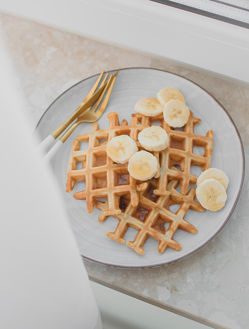 Waffles with banana and maple syrup