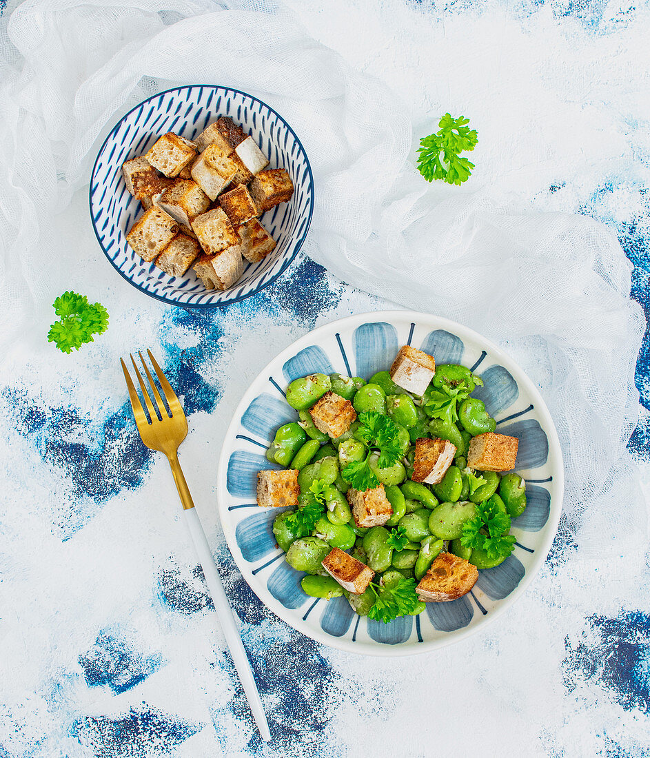 Broad bean salad with croutons