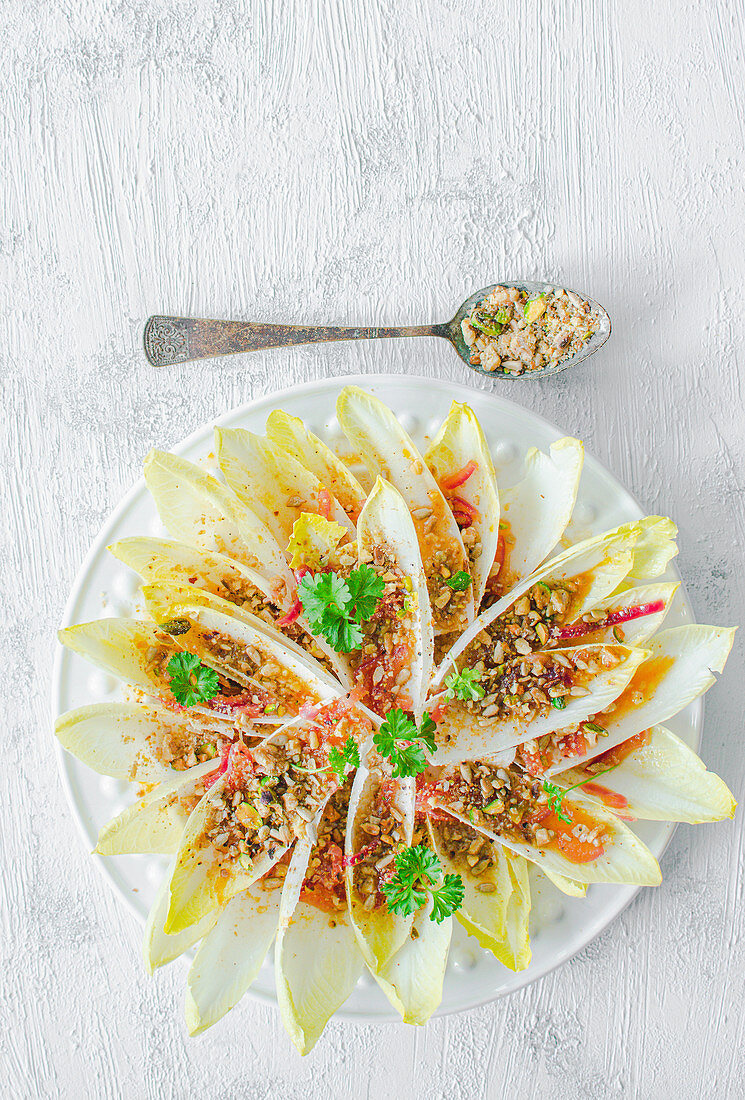 Chicory with nuts, onion and orange dressing