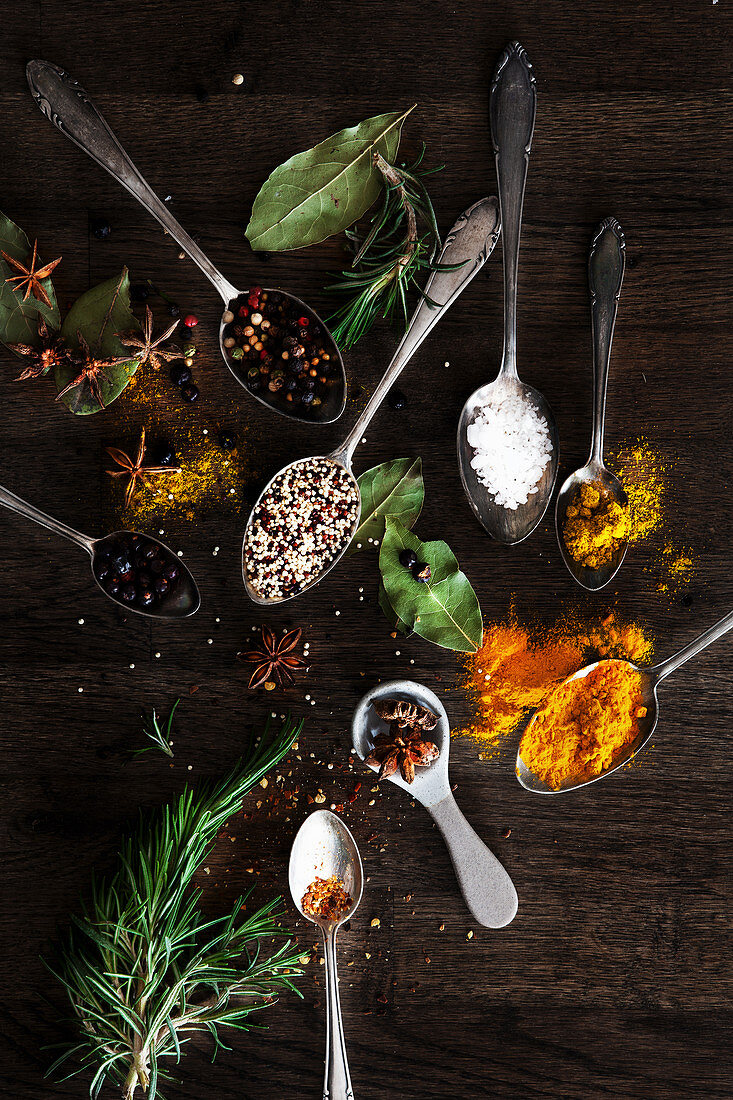 An assortment of different spices and herbs on spoons