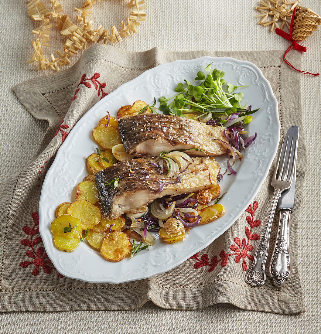 Carp fillets with onions on thinly sliced potatoes