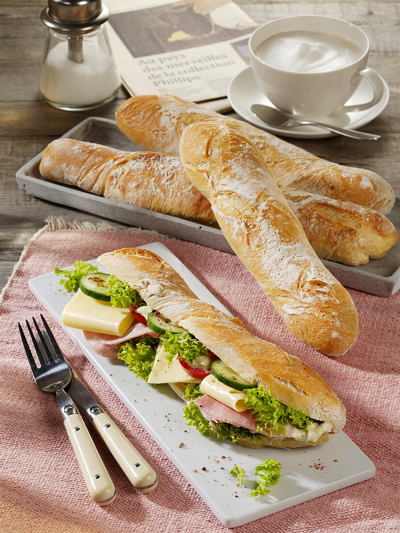 French Flûte bread topped with ham, cheese and salad