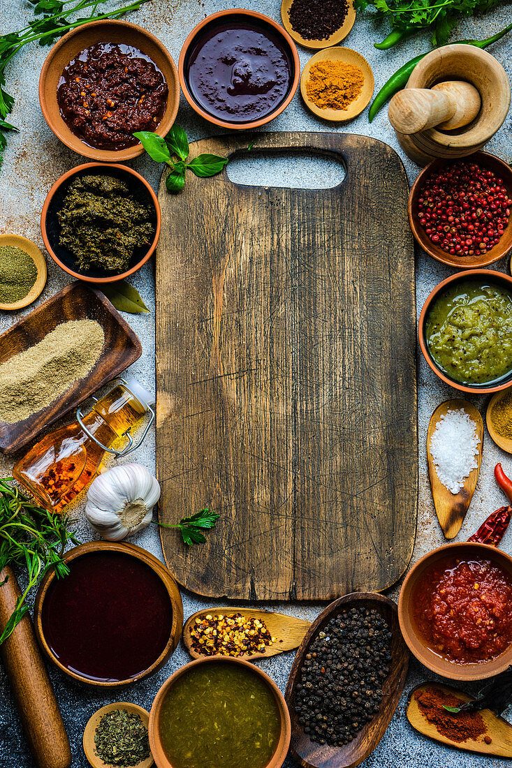 Flat lay of variety of traditional Georgian spices, sauces and herbs