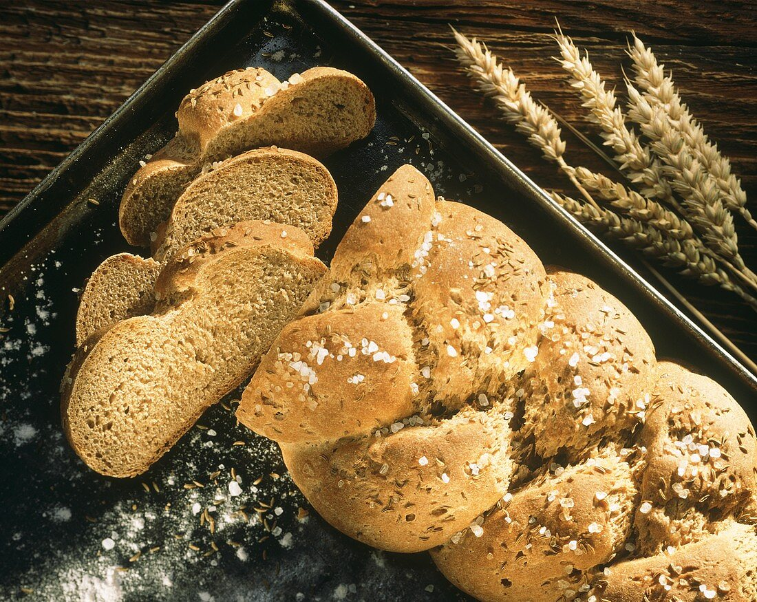 Caraway bread (bread plait with caraway & salt) on baking sheet
