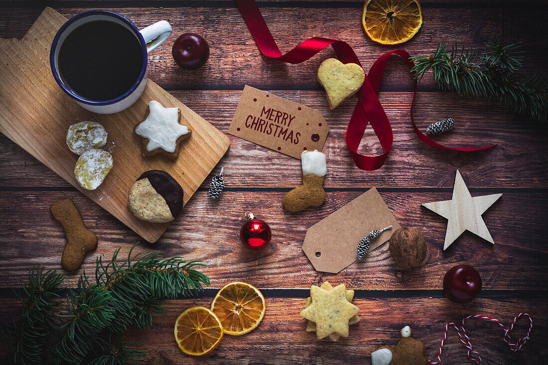 Christmas arrangement of biscuits, coffee and decorations