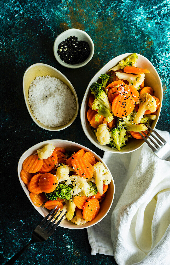 Summer healthy vegetable baked in the bowl with sesame seeds