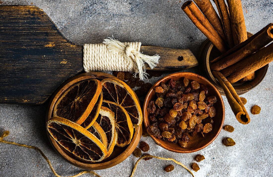 Dried orange slices, sultanas and cinnamon sticks