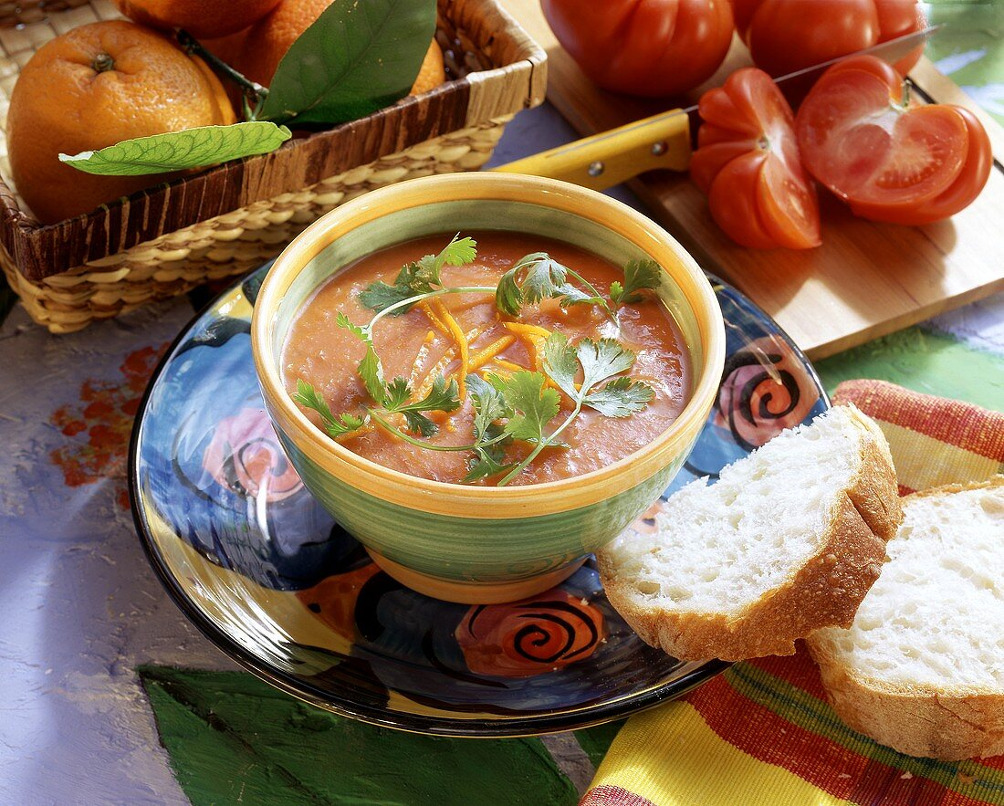 Tomato & orange soup garnished with parsley in small bowl