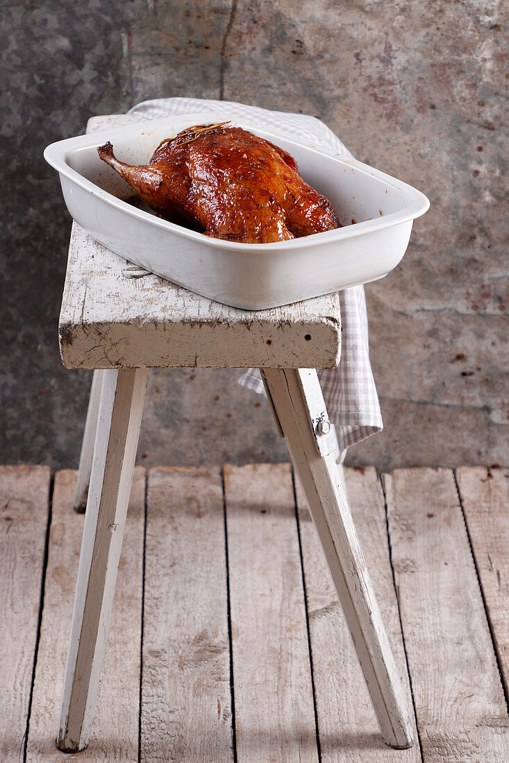 Roasted duck in baking dish