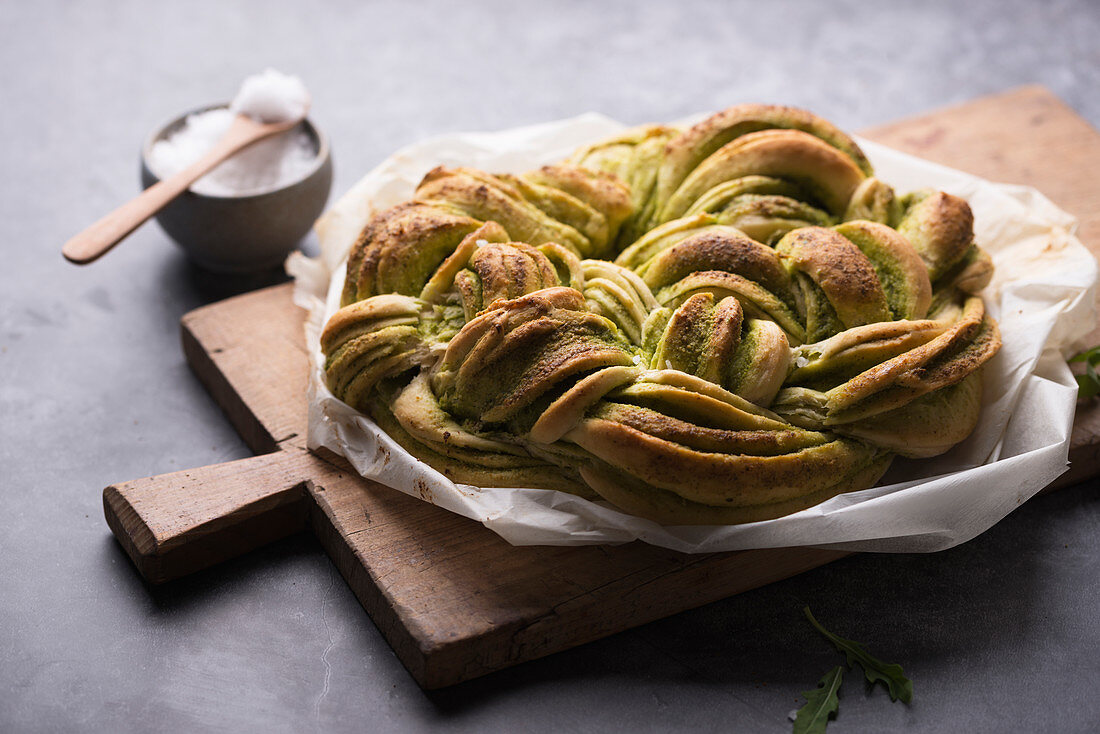 Vegan bread wreath filled with rocket pesto