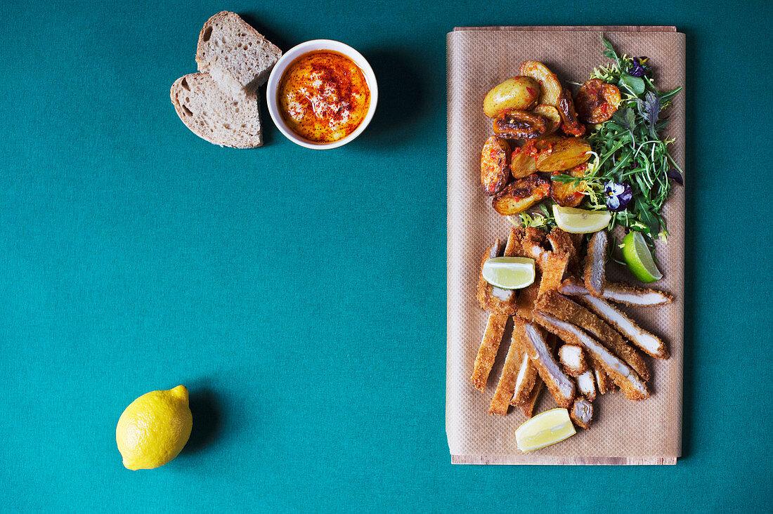 Celeriac hummus, schnitzel à la Tel Aviv and harissa potatoes