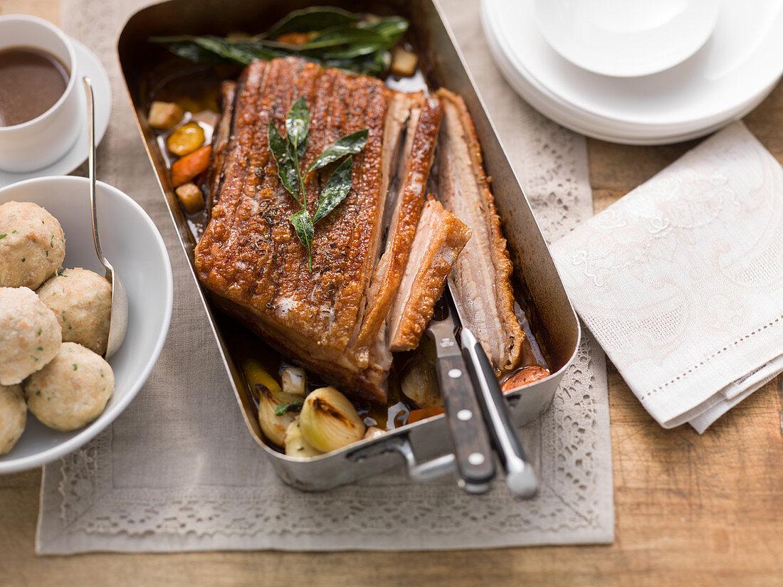 Crispy roast pork with bread dumplings