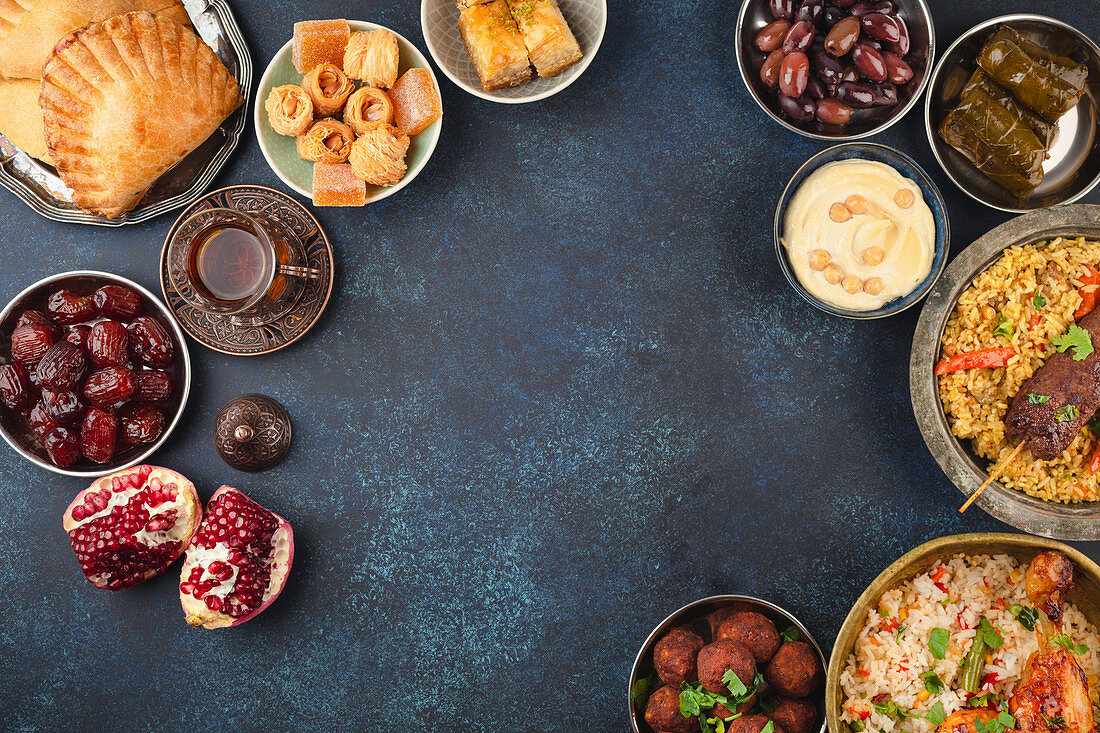 Ramadan kareem Iftar party table with assorted festive traditional Arab dishes