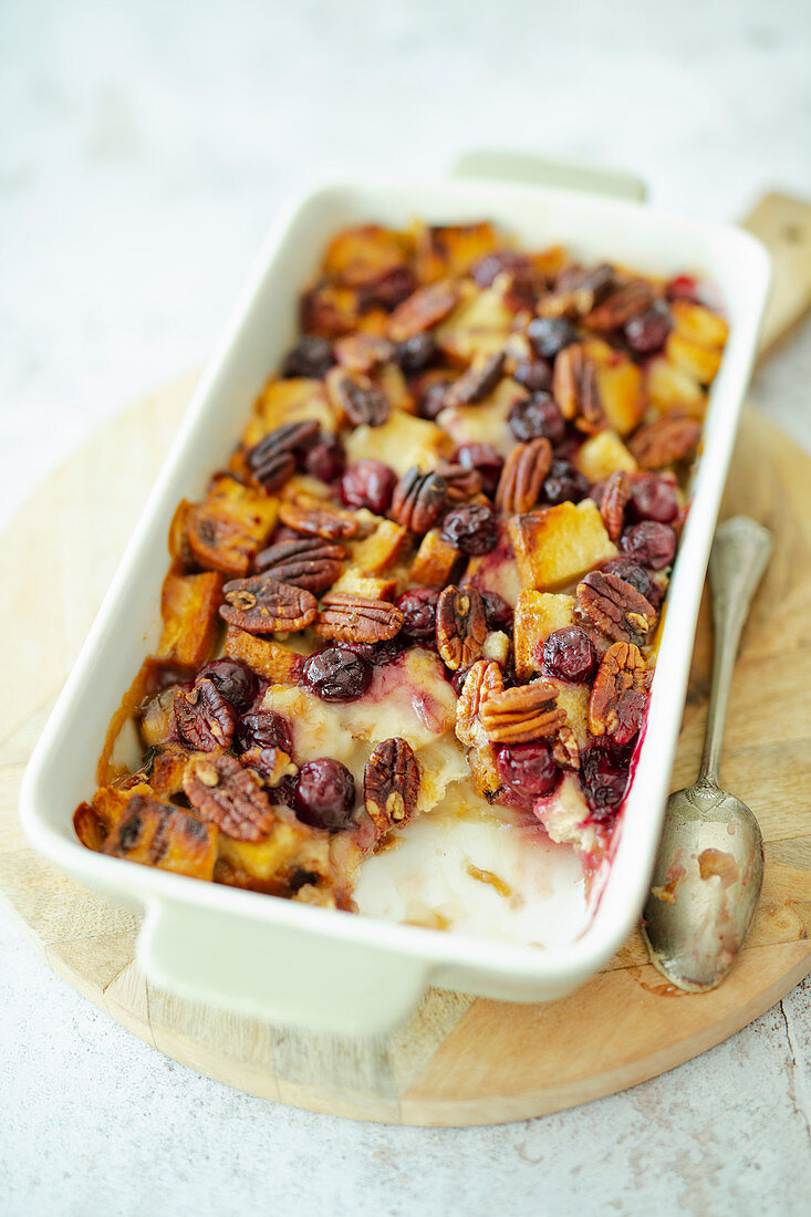 Vegan bread pudding with coconut milk, maple syrup, cherries and pecan nuts