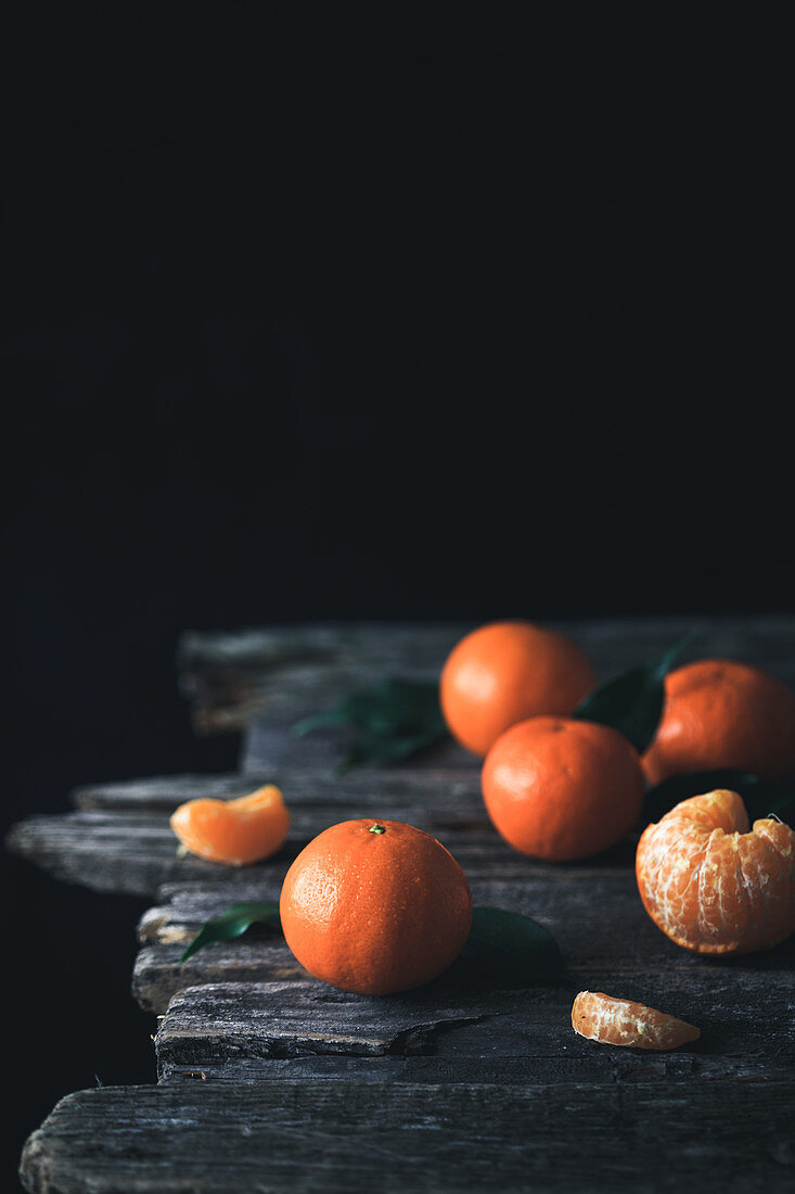 Clementines on a wooden surface