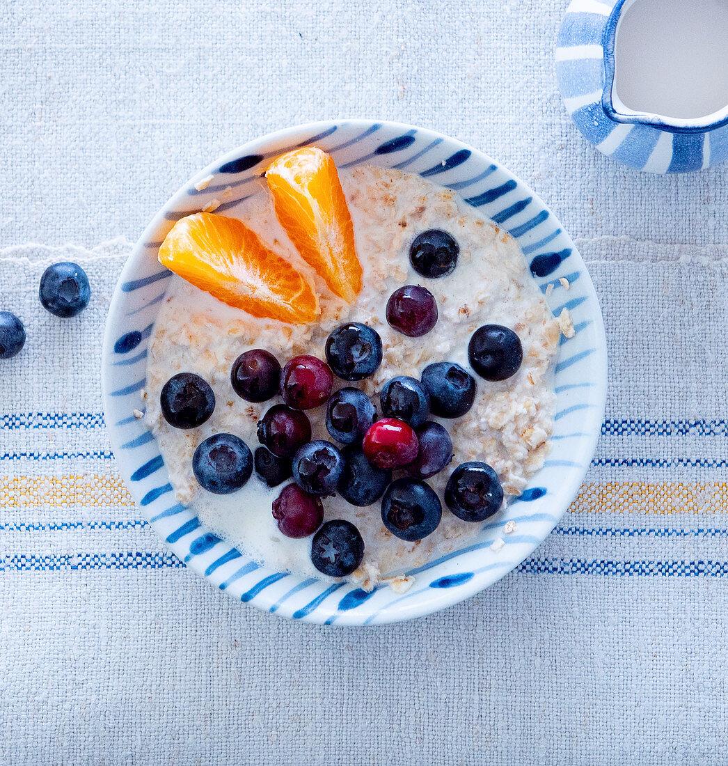 Porridge with blueberries and mandarins