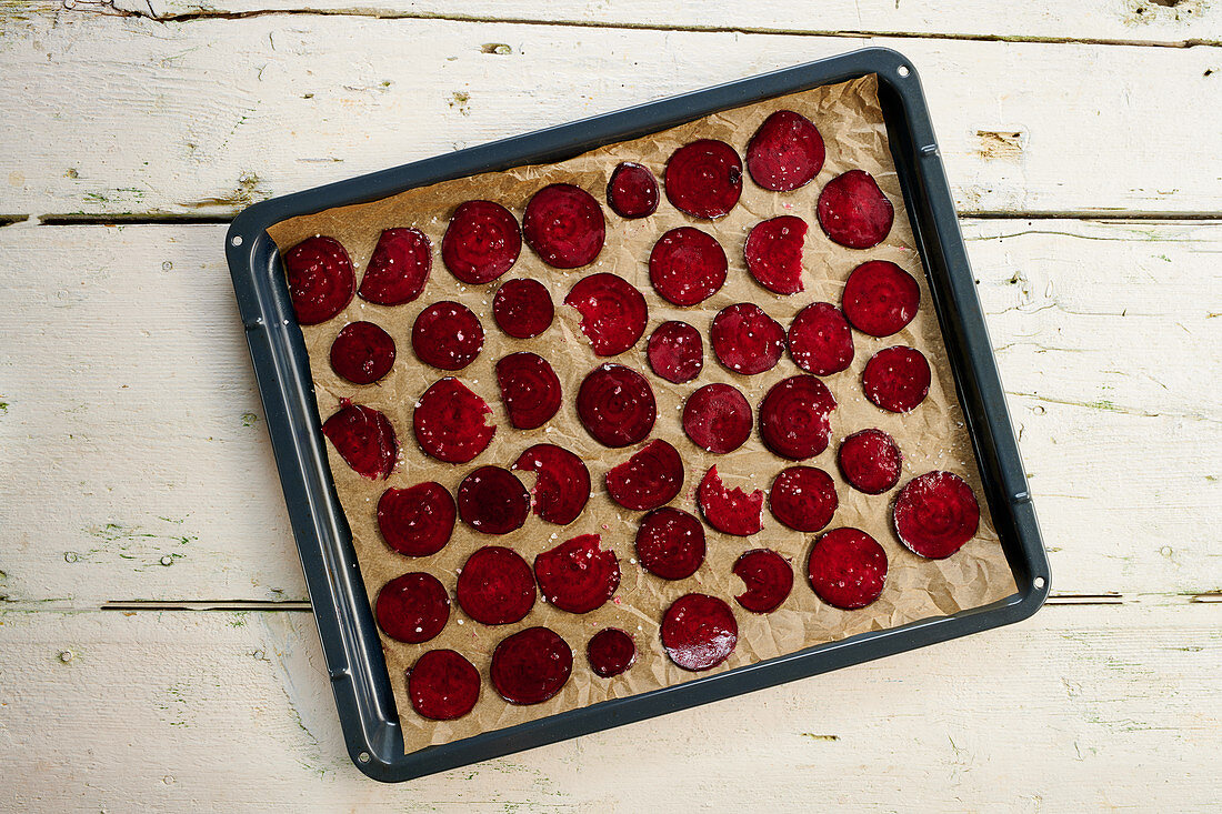 Beetroot crisps on a baking tray