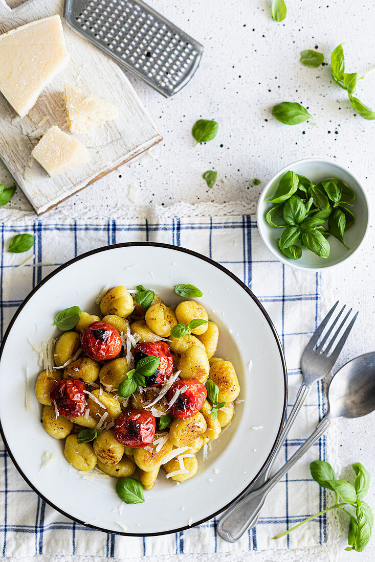 Fried gnocchi with baked tomatoes, basil and parmesan