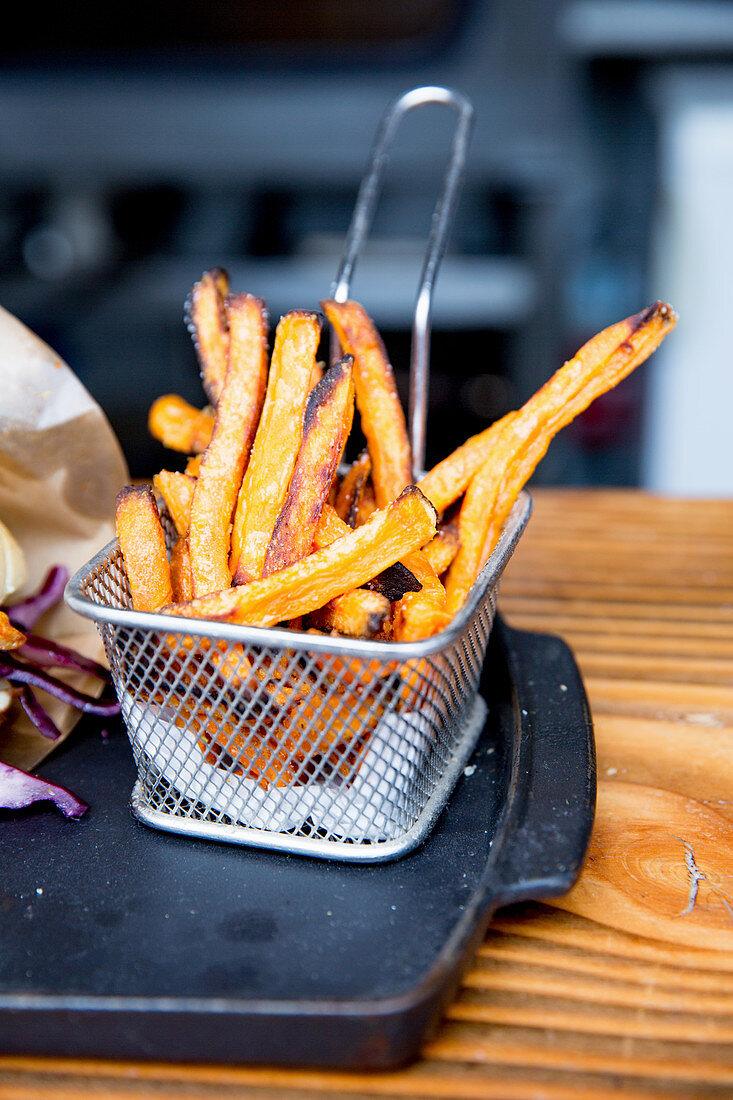 Sweet potato fries in a wire basket