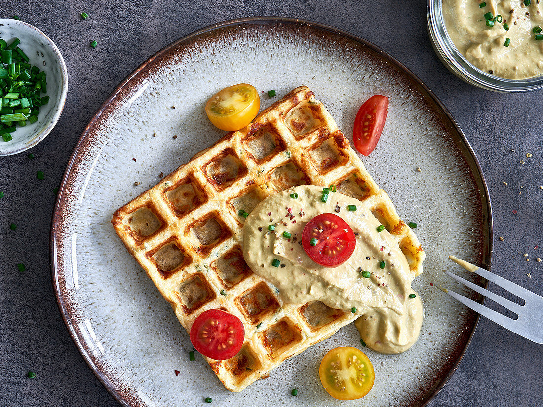 Potato waffle with tomatoes and cream cheese dip