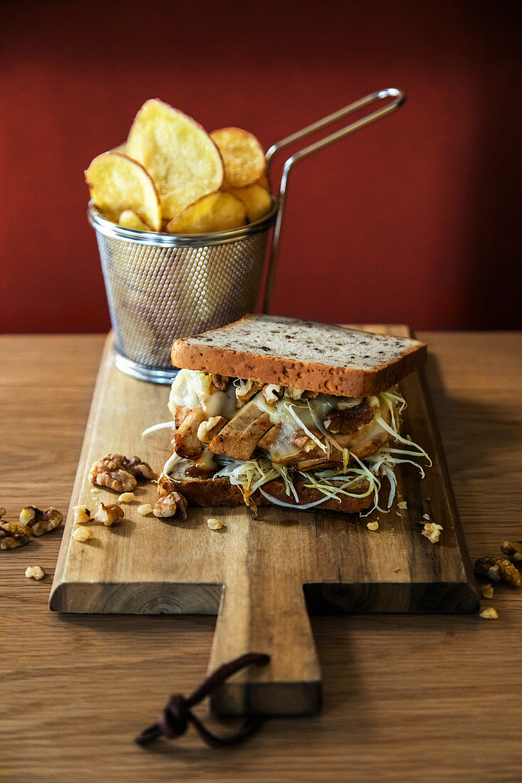 Sandwich with gorgonzola dolce, chicken breast, walnuts and white cabbage salad