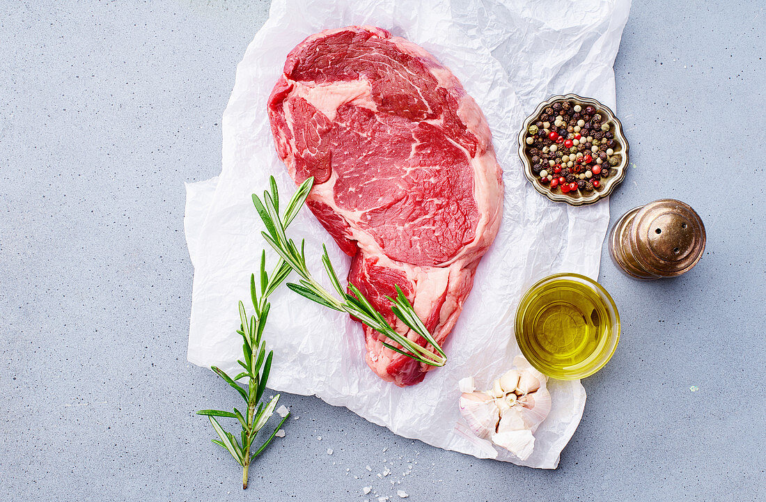 Black Angus prime beef chuck roll steak with fresh rosemary, thyme, olive oil, garlic and spices
