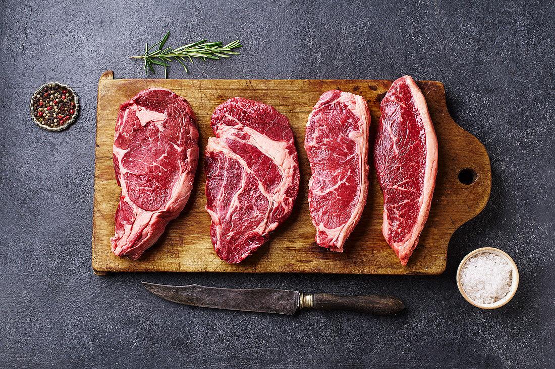Variety of fresh Black Angus Prime raw beef steaks
