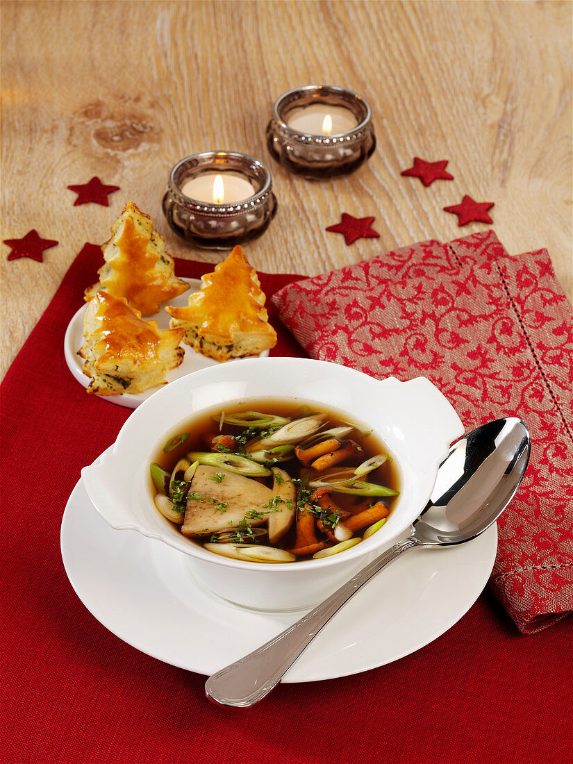 Clear mushroom broth with herb puff-pastry Christmas trees
