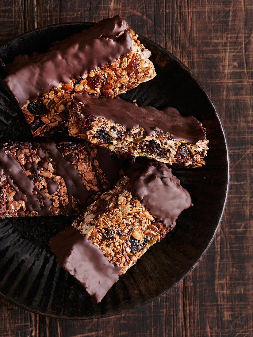 Homemade granola bars dipped in chocolate