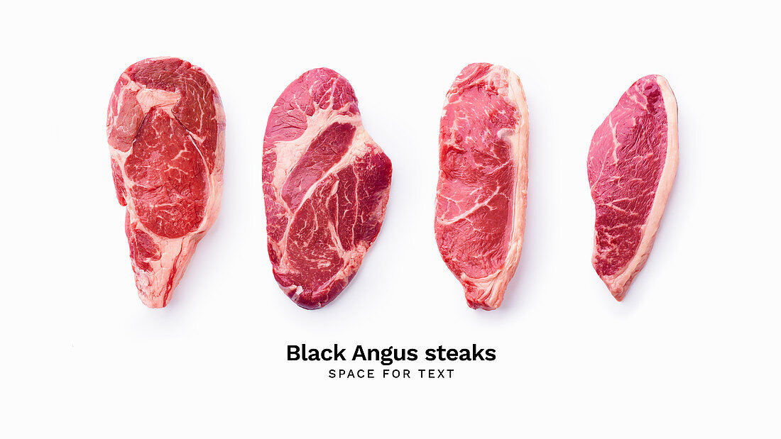 Black angus prime beef steak variety isolated on white background with copy space
