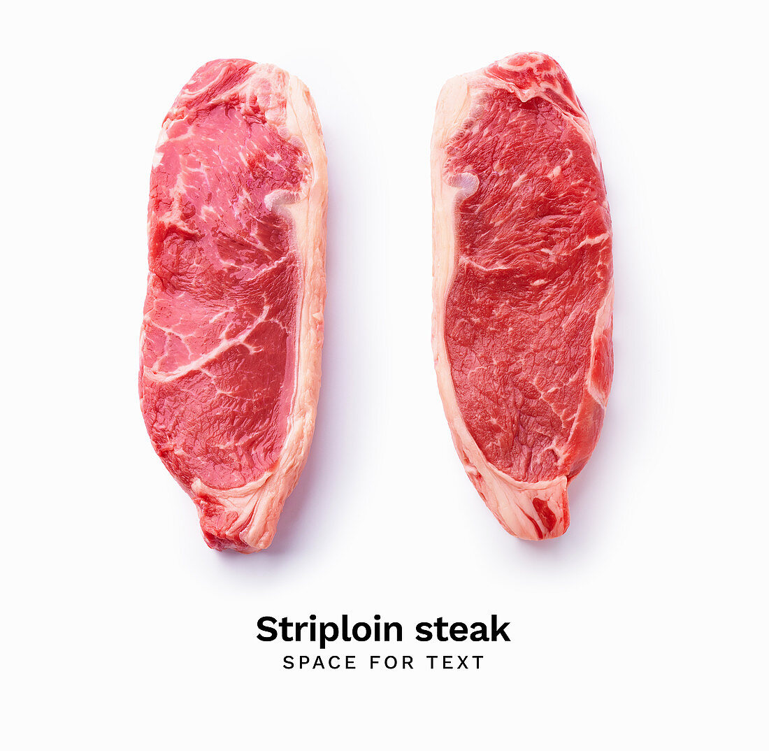 Black angus prime beef striploin steak isolated on white background with copy space