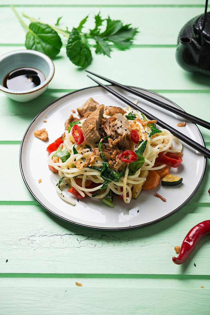 Asian noodles with vegetables, mizuna and misome salad and mock duck (vegan duck made from wheat protein)