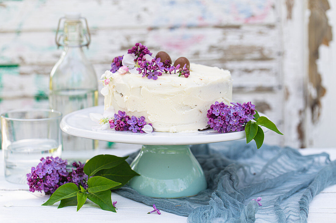 White spring cake with lilacs