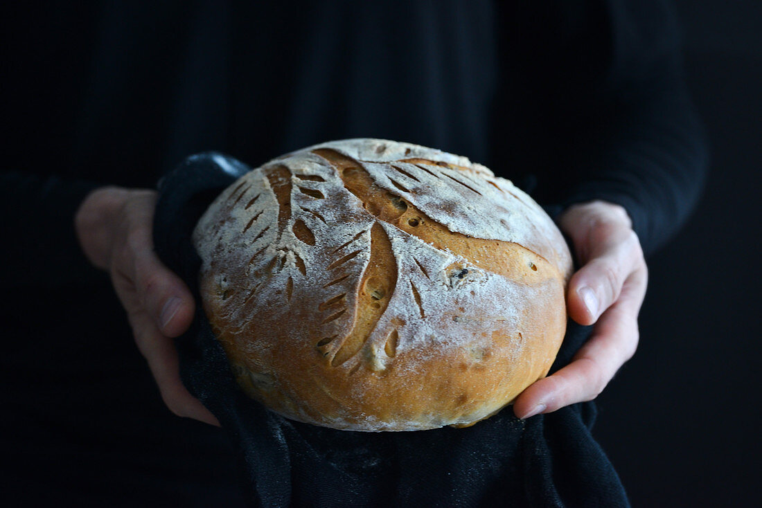 A loaf of bread in your hands