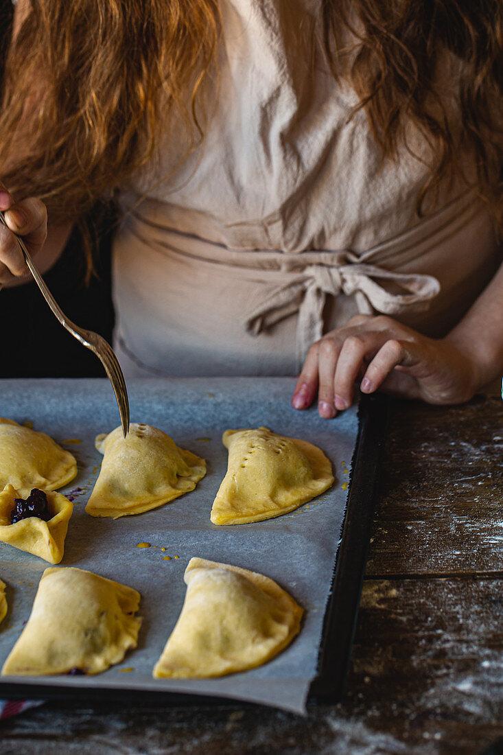 Girl preparing pies