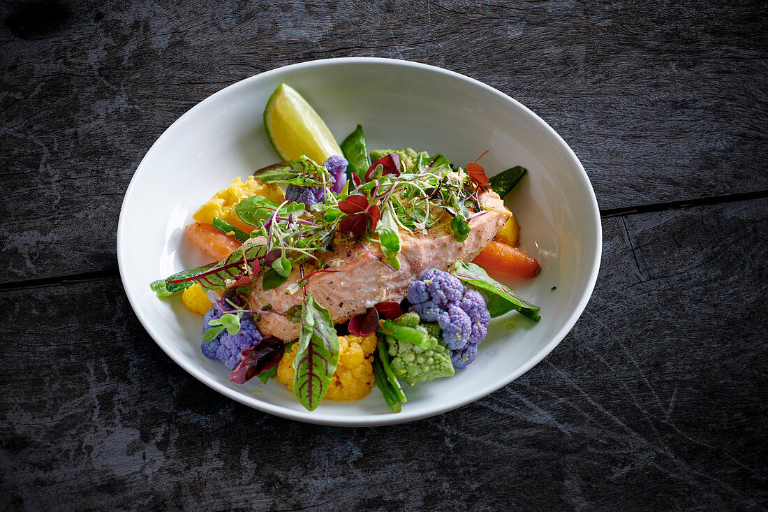 Steamed salmon with colorful vegetables