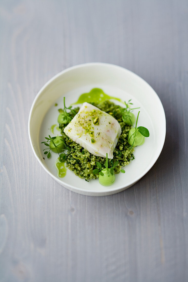 Zander and cardamom confectionary, with green tea and pistachio couscous
