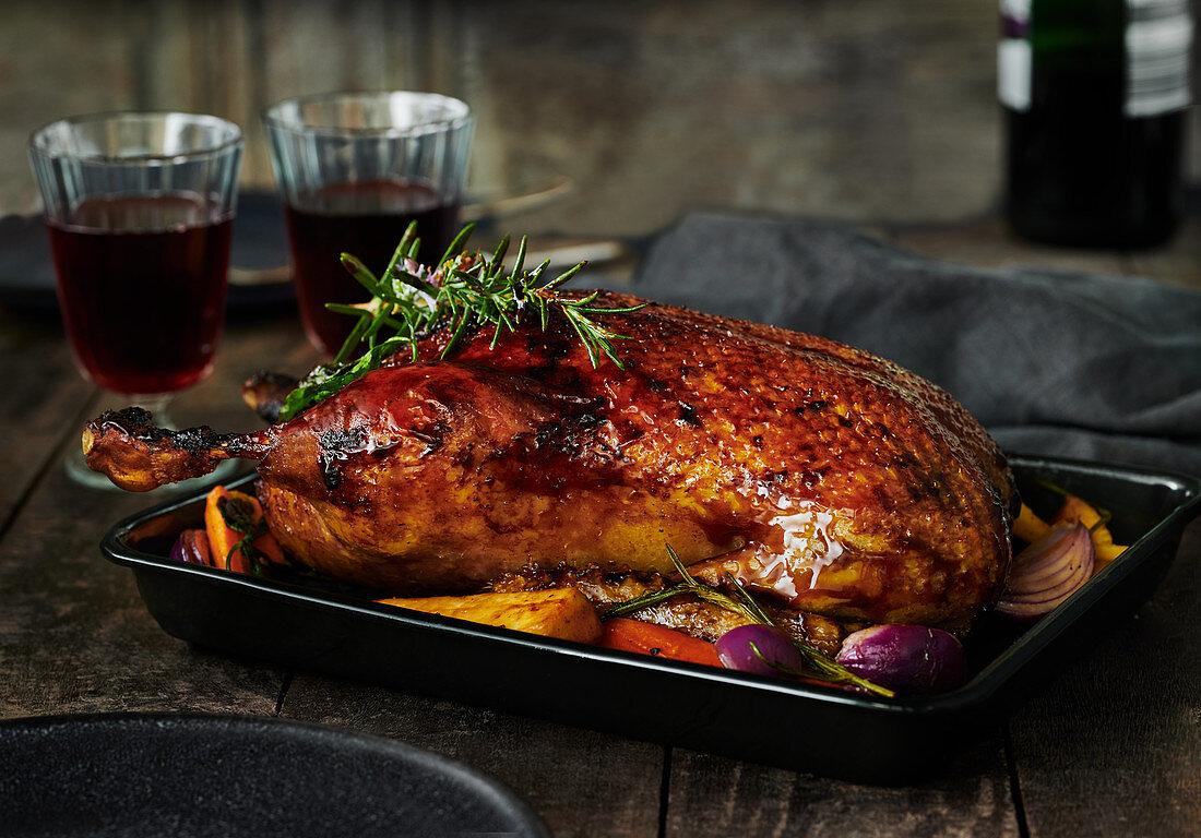 Crispy roast duck in a black baking dish