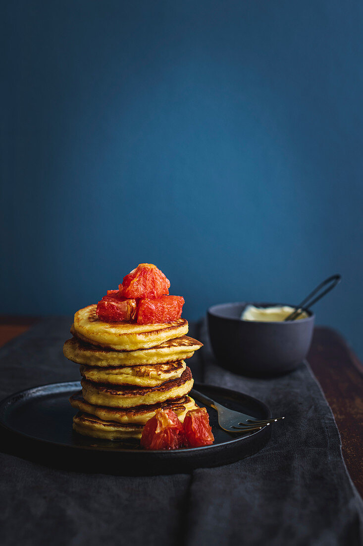 Lemon ricotta hotcakes with caramel-poached grapefruit quarters