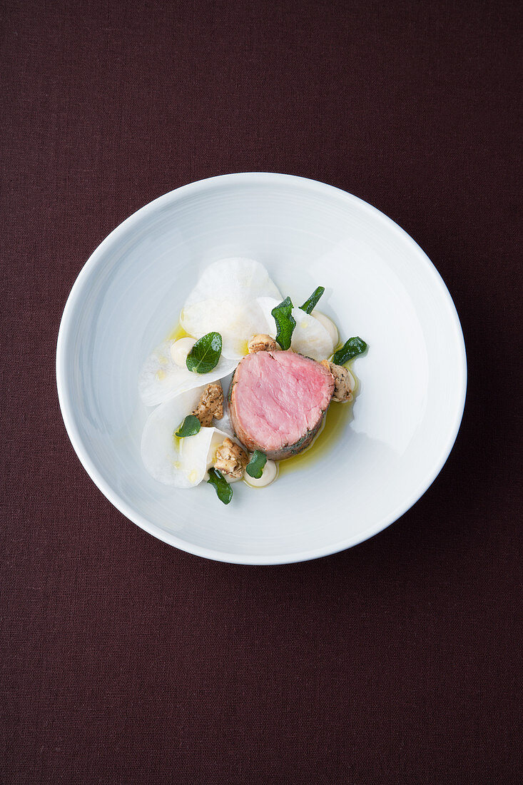 Veal fillet with sage oil, turnips and hazelnut brittle