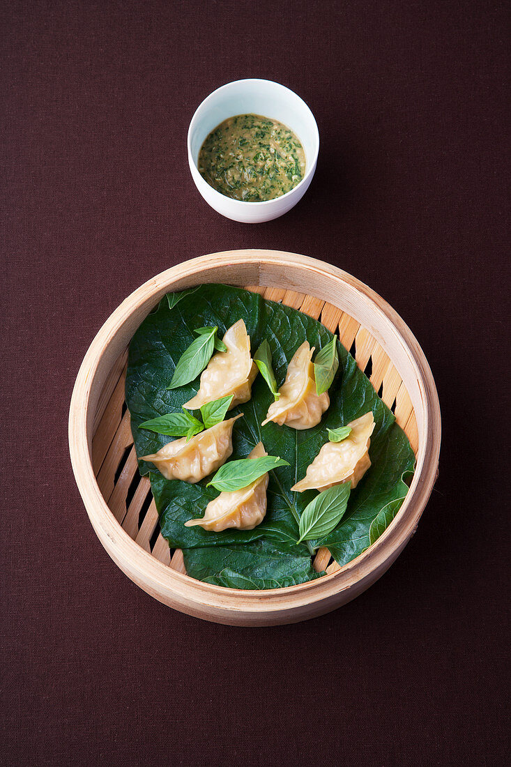 Shrimp dim sum steamed in pepper leaves with miso salsa
