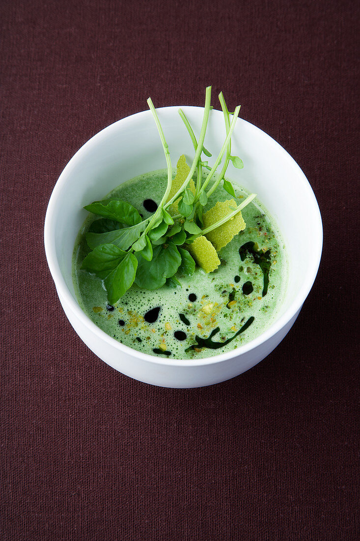Water cress and all spice soup with pistachio gremolata