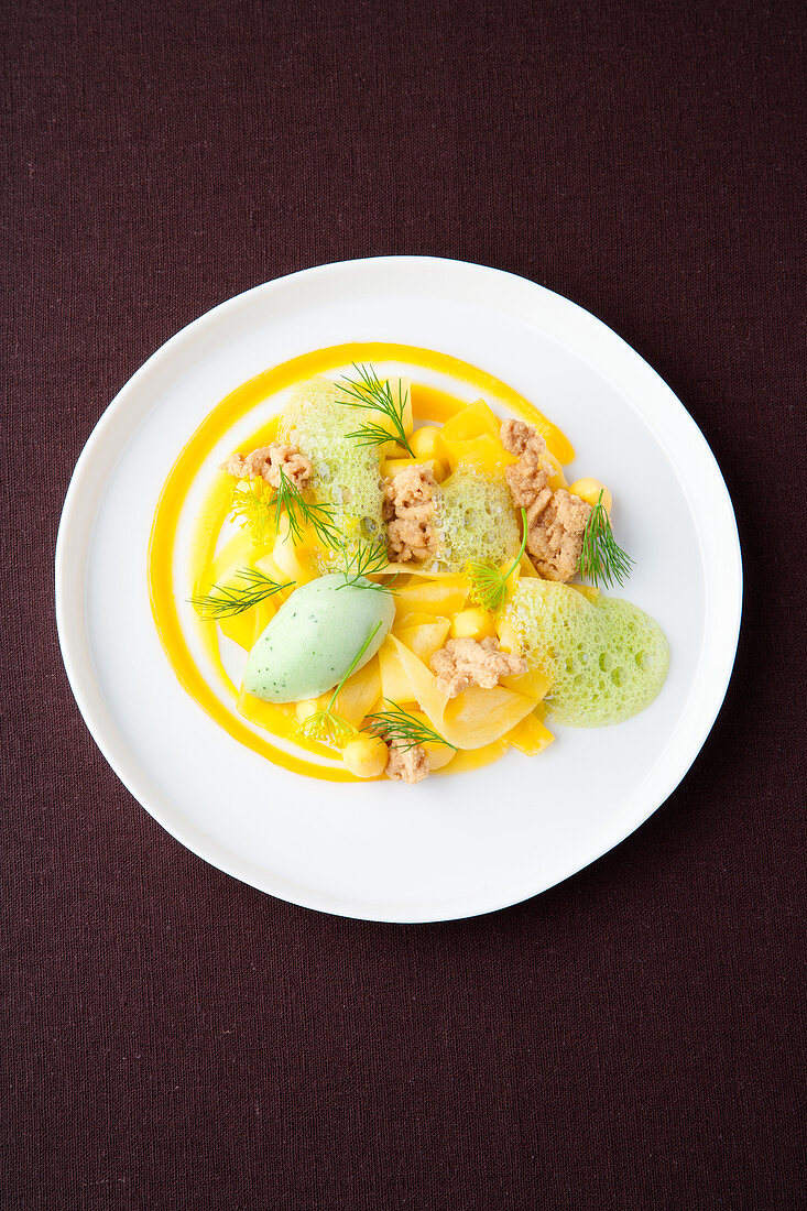 Dill sorbet with mango and macadamia crunch